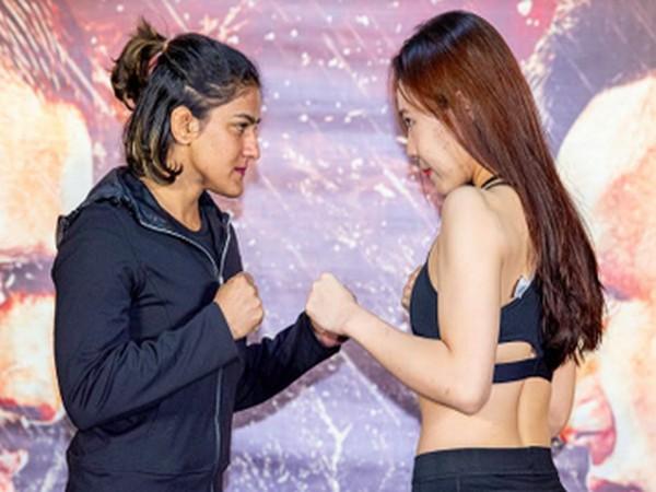 Ritu Phogat squaring off against Nam Hee Kim (Photo/ TGF MMA Twitter)