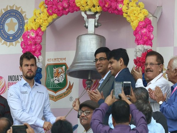Viswanathan Anand and Magnus Carlsen ringing the bell at Eden Gardens on day two (Photo/ BCCI Twitter)