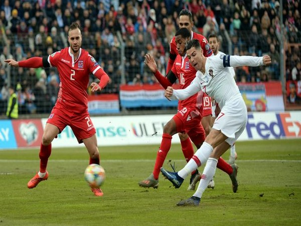 Players struggling for ball during Portugal-Luxembourg clash.