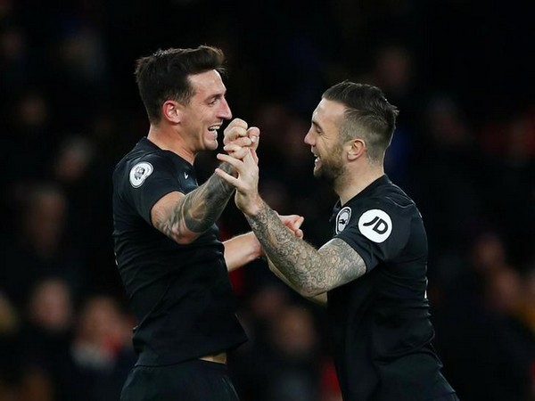 Brighton's Lewis Dunk and Shane Duffy celebrate after the match
