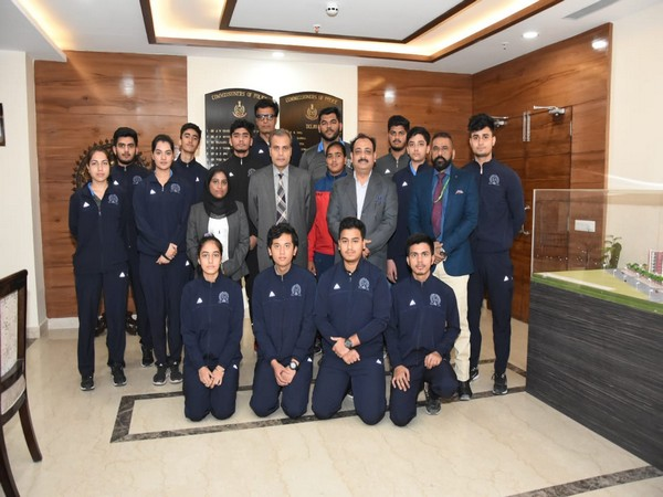 Commissioner of Police Amulya Patnaik with the young sports persons nurtured under 'Mission Olympic 2020' in New Delhi on Monday. Photo/ANI