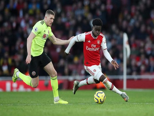 Arsenal's Bukayo Saka in action with Sheffield United's John Lundstram
