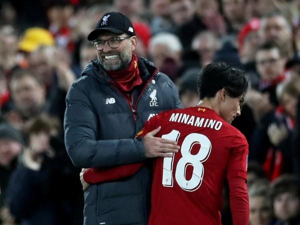 Liverpool manager Jurgen Klopp with Takumi Minamino