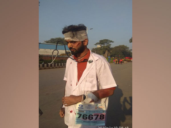 A participant dressed up as a beaten-up doctor during Mumbai Marathon.
