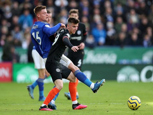 Chelsea's Mason Mount in action with Leicester City's Harvey Barnes