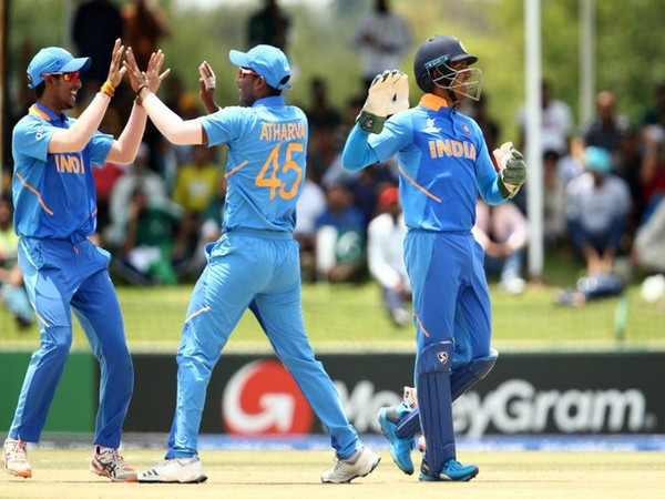 Indian players celebrating after taking a wicket. (Photo/Cricket World Cup Twitter)