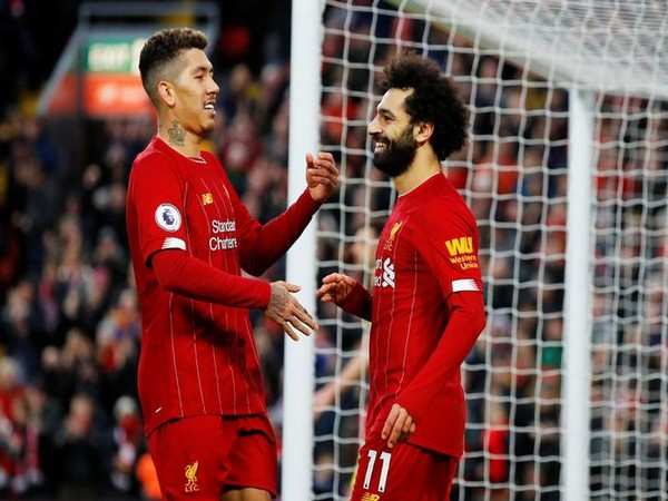 Liverpool's Roberto Firmino with Mohamed Salah