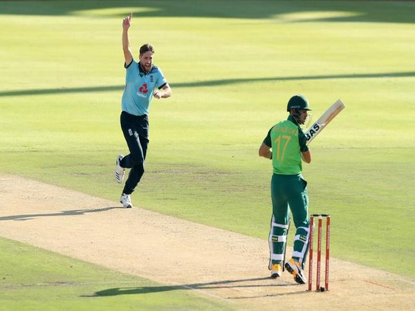 England's Chris Woakes celebrates taking the wicket of South Africa's Reeza Hendricks in first ODI