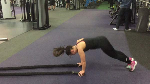 Double arm wave with a burpee